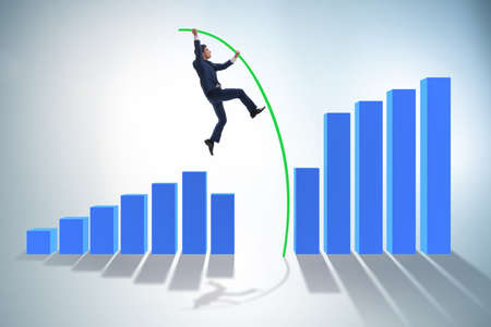Businessman vault jumping over bar charts