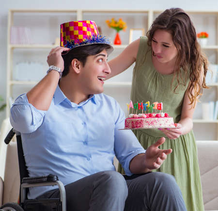 The young family celebrating birthday with disabled person Zdjęcie Seryjne - 138644400