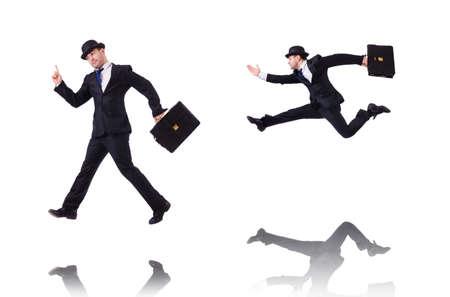 Lustiger Geschäftsmann, der auf Weiß springt