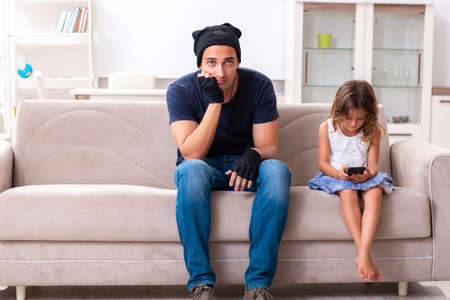 Child trafficking and abuse concept with small girl Stock Photo