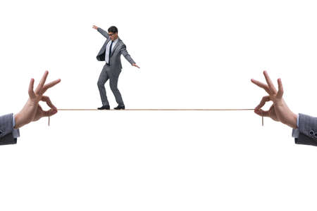 The businessman walking on tight rope