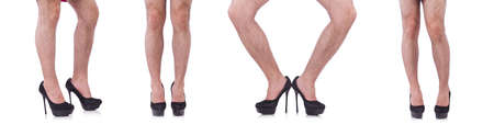Man wearing woman shoes isolated on white