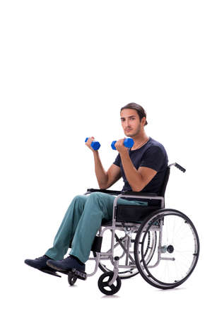 Young disabled man doing physical exercises isolated on white