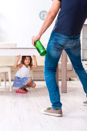 Drunk father in domestic child abuse and violence concept 版權商用圖片