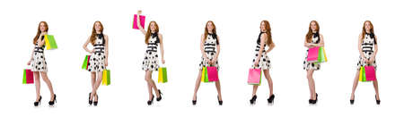 The young woman with shopping bags on white Reklamní fotografie