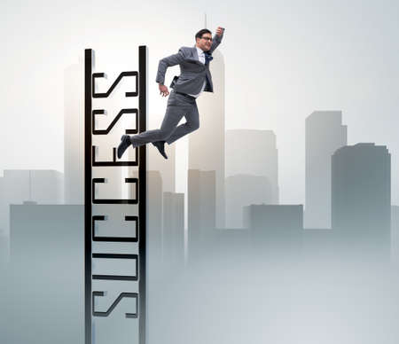 Businessman slipping from the top of ladder