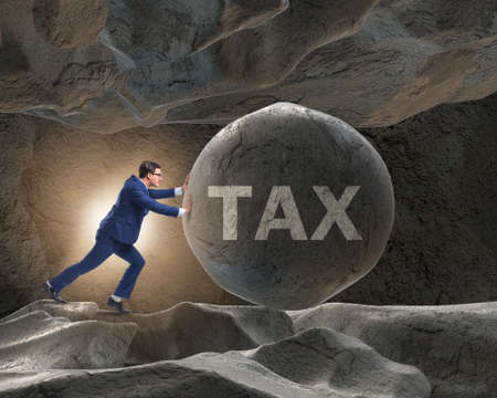 The businessman in high taxes business concept
