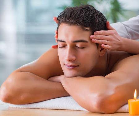 Handsome man during spa massaging session