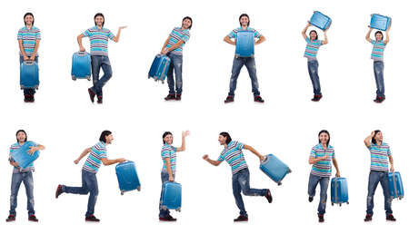 The young man travelling with suitcases isolated on white