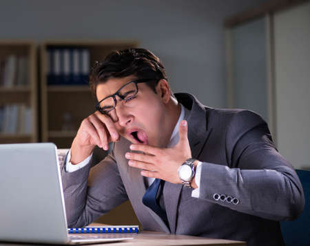 Businessman staying in the office for long hours Stok Fotoğraf