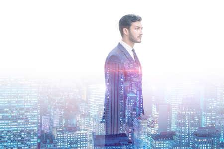 Successful businessman against cityscape in business concept Reklamní fotografie