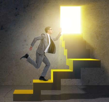 Young businessman climbing career ladder Reklamní fotografie