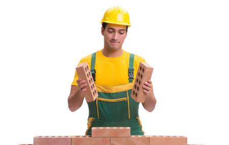 The handsome construction worker building brick wall Archivio Fotografico