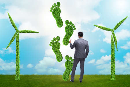 The carbon footprint concept with businessman Stock Photo