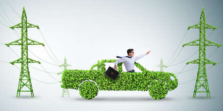 Electric car and the green energy concept Stock Photo