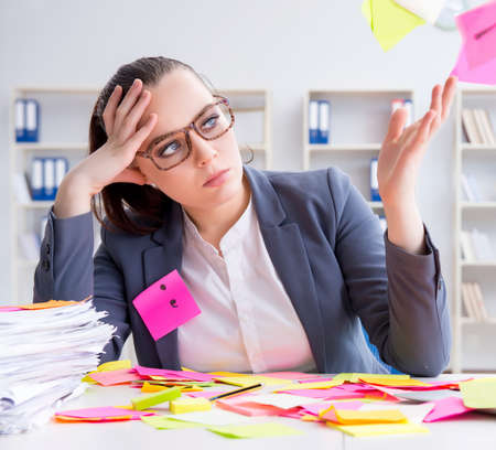Businesswoman with conflicting priorities in office