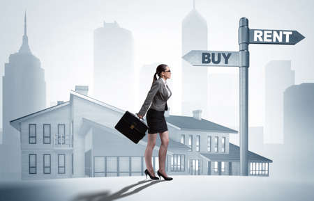 Businesswoman at crossroads betweem buying and renting