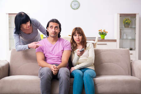 Young family and mother-in-law in family issues concept