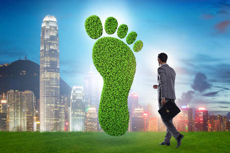 Carbon footprint concept with businessman Stock Photo - 140618140