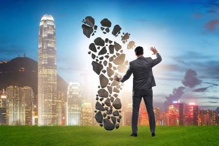 Carbon footprint concept with businessman Stock Photo