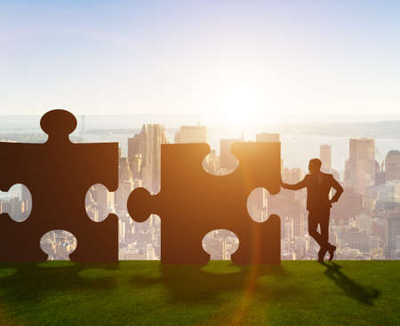 The business metaphor of teamwork with jigsaw puzzle
