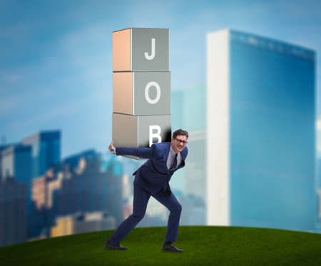 Businessman carrying the burden of his job Imagens