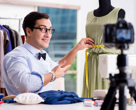 Young man working as fashion video blogger