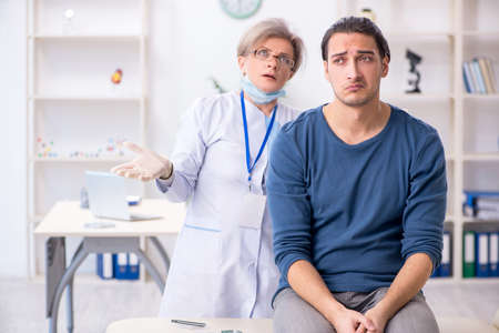 Young patient visiting doctor in hospital