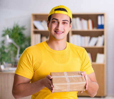 Delivery man delivering parcel box 写真素材