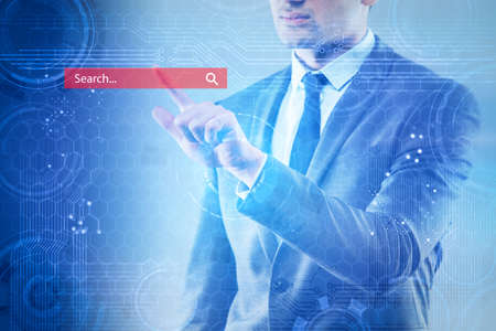 Search concept with the businessman pressing button