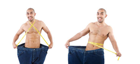 Man in dieting concept with oversized jeans Banque d'images