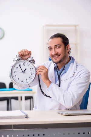 Young handsome male doctor working in the clinic