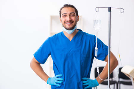 Young male doctor working in the clinic Stock Photo
