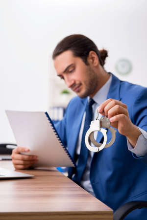Young male businessman employee working in the office Imagens