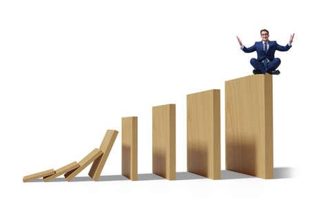 Businessman in domino effect concept