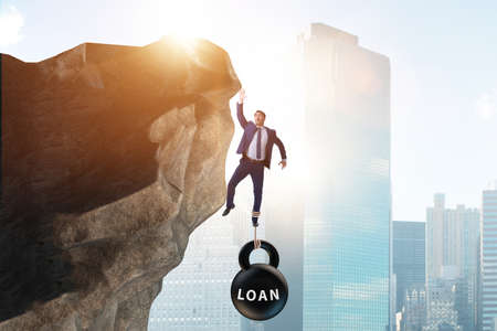 Concept of debt and load with businessman Stok Fotoğraf