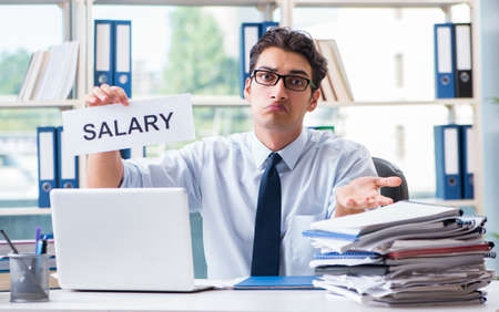 Young businessman asking for salary increase in office