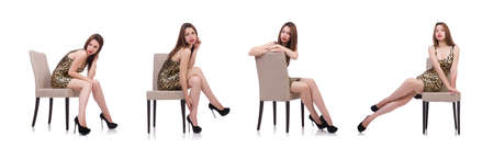 The woman sitting on the chair isolated on white