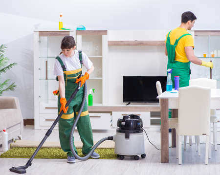 Cleaning professional contractors working at house Standard-Bild