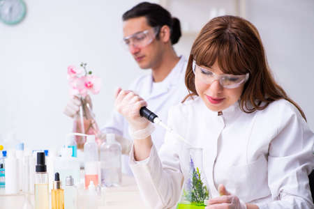 Two chemists working in the lab 写真素材