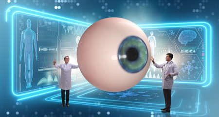 The doctor examining giant eye in medical concept