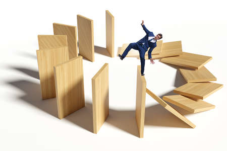 Businessman in domino effect concept