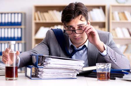 Young businessman drinking from stress Reklamní fotografie