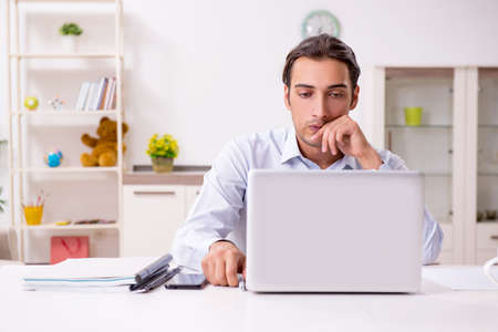 Young male businessman working at home Banco de Imagens