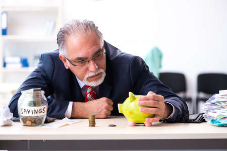 Old male accountant in budget planning concept