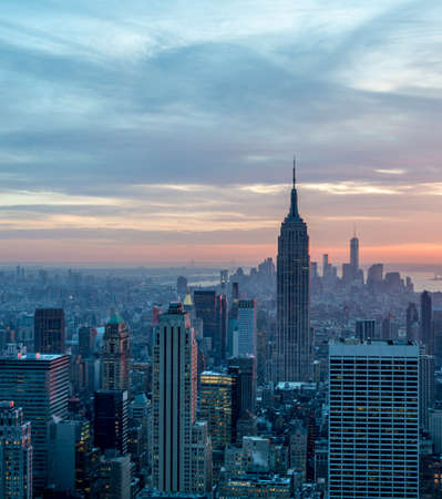 The view of new york manhattan during sunset hours