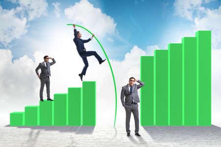 The businessman vault jumping over bar charts