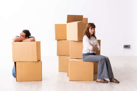Young pair and many boxes in divorce settlement concept Reklamní fotografie