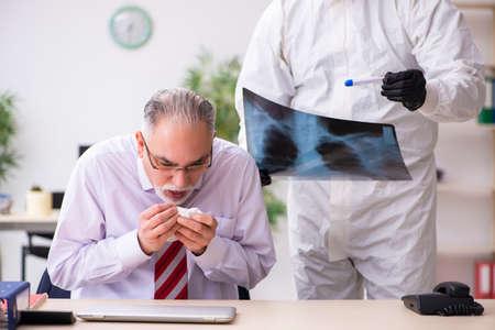 Old employee catching coronavirus at workplace