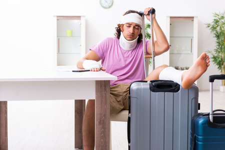 Young injured man preparing for the trip Stock Photo
